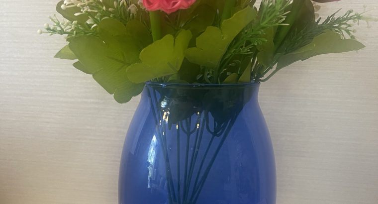 Glass flower vase with flowers